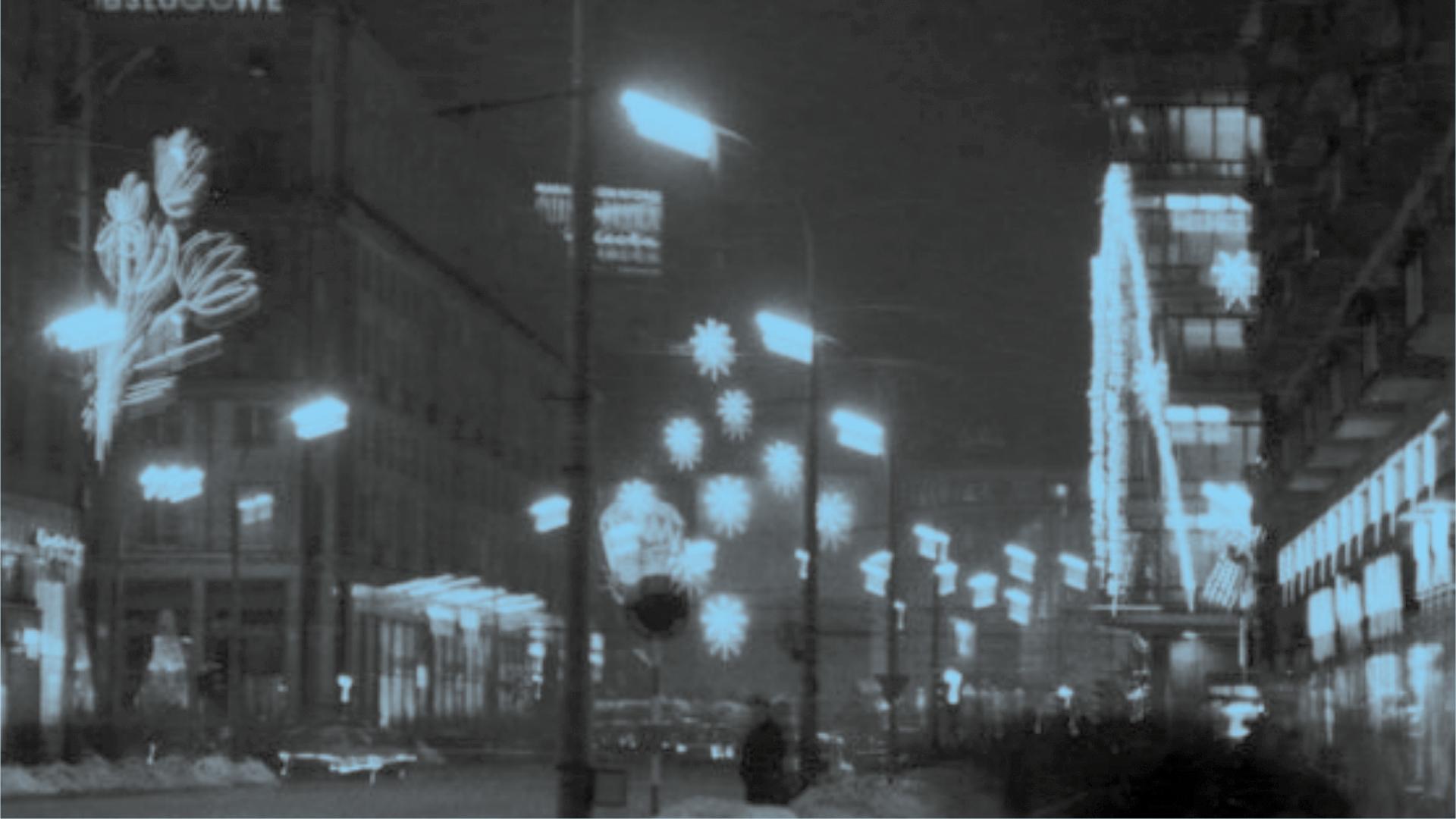 zdjęcie nocne Warszawy, wszystko niewyraźne, dużo świateł wieżowców, latarni, neonów